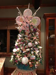 This candy-themed Christmas tree is Angela Bagsby's favorite of the 11 in her Gallatin home.