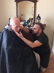 "Lenny White, ""the dementia friendly barber"" provides a shave for Bill Wade, a resident of Brightview Randolph."