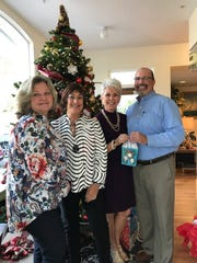 Woman's Club of Stuart presented Molly's House with $750 in gift cards. Pictured are, from left, Polly Delater, program director of Molly's House; Janie Copes, president of Woman's Club of Stuart; Deb Pfrogner, Woman's Club of Stuart member; and , Bill West, Molly's House CEO.