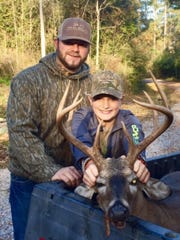 Judd Gipson, 11, hunted with his dad, Will, in Lamar County to collect this 200-pound 8-point.