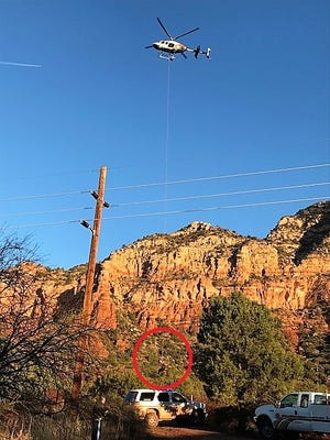 A teen is lifted to safety Thursday, Jan. 11, 2018, after being stranded on a Sedona mountain overnight.