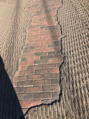 Some residents who live near Haynes Street in Pensacola are upset after crews on Monday, Jan. 15, 2018, paved over the street's original brick paving. The original paving was unearthed in August.