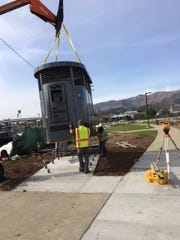 Workers install a Portland Loo in January 2018 at Kellogg Park in Ventura, California.