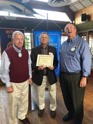 Left, sponsor John Napier, and right, President-elect Bruce Irwin congratulate new Rotary Club of Stuart member Bob Tinsman.