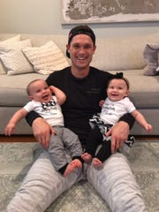New England Patriots wide receiver and Wyckoff native Chris Hogan holds his twins, who were born in March just one month after Hogan won Super Bowl LI.