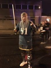 Eagles fan Frank Crane parties on Broad Street after the historic Super Bowl win Sunday night.