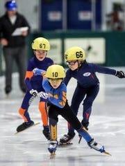 Quinn Derheimer, 8, Indianapolis, takes strides ahead of the competition.