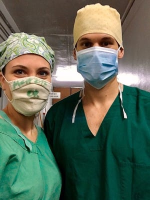 Shannon and Bryan Pierce worked at the Memorial Christian Hospital in Bangladesh for nearly a month. Here they are shown preparing to scrub in for their first surgical case at the hospital.