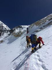 Members of Allan McLeland's band climb toward the top of Everest.