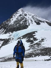 Allan McLeland, with the summit of Mt. Everest in the