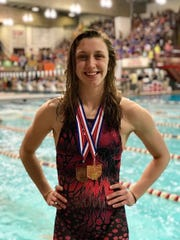 Lancaster senior Olivia Schmelzer poses with Division I 100 freestyle state championship medal and third place 50 free medal.