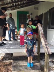 Teen docents at the Laura Riding Jackson home on the grounds of the Environmental Learning Center offer tours to members of the Boys & Girls Clubs of Indian River County.