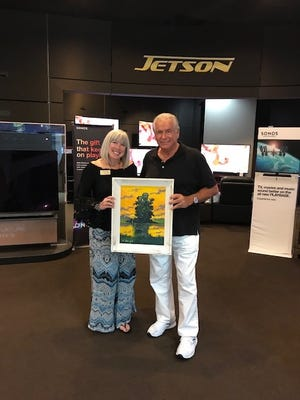 Philanthropist Jerry Morabito of Vero Beach presenteddrawing winner Shaun Kelly with the original Rodney Demps Highwaymen painting at the annual Jetson Highwaymen Art Show.