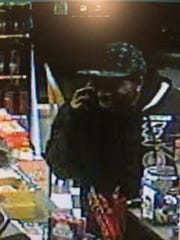 A second photo of a man suspected of theft at the Manchester Rutter's.