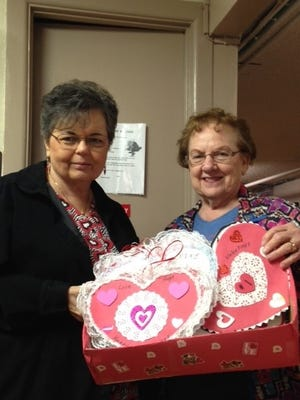 Billie Ivy and Jimmie Campbell deliver Valentine's cards made by the Eula Ladies Club to residents of a nursing home in Clyde.