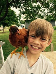 Braylon poses for a photo with his chicken, Helser.