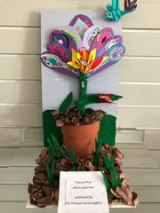 Aliah Cotton, Mackenzie Williams, Victoria Vendryesand Sarah Ward placed first in art with their 3-D paper art project, which depicted a unique plant and pollinator.