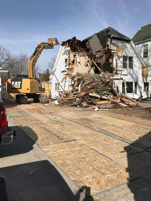 Beacon House's add-on is pictured being demolished on March 21.