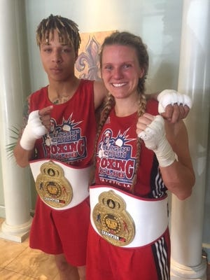 Bralon Collins and Candice walls of the Ragin' Cajun amateur boxing club display their 2018 State Golden gloves belts.