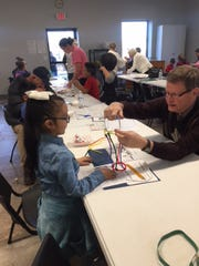 Members of Floral Heights United Methodist Church volunteer on Thursdays to spend time tutoring and enjoying crafts with students from Zundy Elementary. The program is called The Heights.