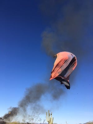 Ronnie and Becky Gandy were on board a hot air balloon in Phoenix, Ariz., when the structure went up in flames. No one was injured.