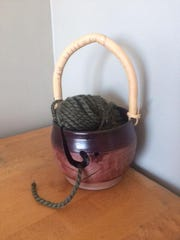 One of Jesie Stefani's yarn bowls with a handle made of bamboo.