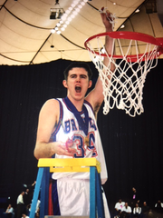 Jake Holder takes his turn cutting down the net as Tecumseh celebrates winning the 1999 Class A state championship.