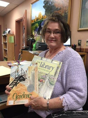 Linda Orr shares her love of reading with preschoolers during Story Time at the Fairview Library.