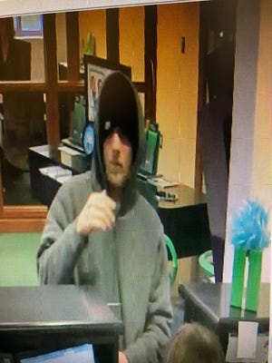 Town of Poughkeepsie police released images of a suspect in a Thursday morning robbery at TD Bank in Poughkeepsie.