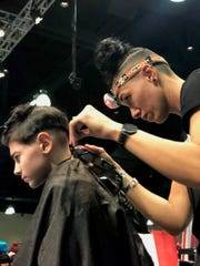 January Fonseca Sabune, a Montclair barber, participates