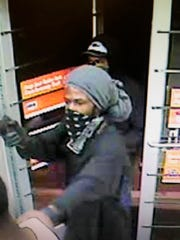 Surveillance video shows one of the suspects wanted for armed robbery at Auto Zone.