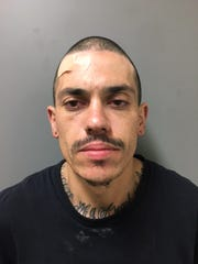 Police allege Edwin Ortiz Martinez, 28, threw away a replica handgun while officers chased him. They said the suspect also was in possession of a dagger-style knife.