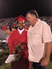 Zion Blue and Ernie Gleason, the man who saved Blue from a burning house when she was 15 months old, reunited at Tioga High School's graduation Friday, March 11.