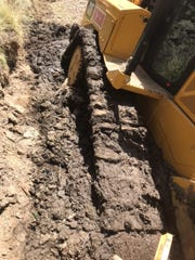 Recent heavy rains softened the ground in northern Washoe County. As a result a bulldozer working on High Rock Canyon Road got stuck. The maintenance project it was being used for is on hold and the road is closed indefinitely. May 22, 2018.