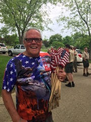 Ryamond Hall, a U.S. Army veteran, of Ontario, said he enjoyed helping honor the nation's veterans who died. He was among more than 50 people who volunteered Saturday at Mansfield Cemetery.