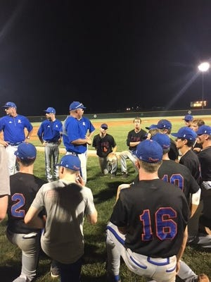 Silver Creek coach Joe Decker talks to his team after the game
