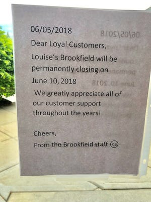 A sign posted at Louise's Trattoria in Brookfield notifies customers of the suburban location's closing next week.