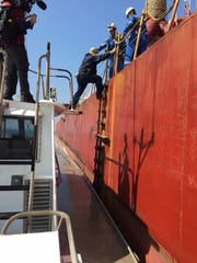 Coast Guard officials are investigating an incident Saturday that resulted in the death of experienced harbor pilot Robert Adams. Here, Adams is seen boarding a ship.