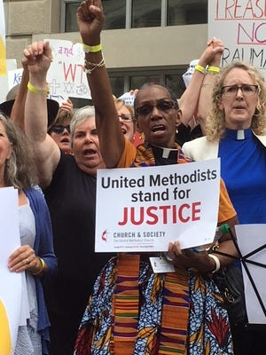 """Women religious leaders protest the administration's """"zero tolerance'' policies Tuesday outside the Customs and Border Protection headquarters."""