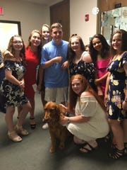 Hudson Golebiewski (center) and his service dog, Oscer, attended Vestal Middle School's eighth grade graduation ceremony Tuesday evening.