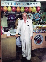 Metropolitan owner Walter Rothenberg is seen at his store during a party celebrating his 90th birthday. Rothenberg owned the store for more than four decades.