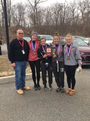 Mueller, left, celebrates with his girls' indoor track captains after the Lancers claimed the Passaic County Relays team championship.