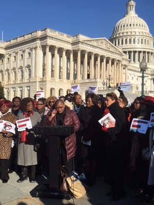 Melanie Campbell, president of the National Coalition on Black Civil Participation, and other women attending the Black Women's Roundtable conference talk to reporters outside the U.S. Capitol in March.