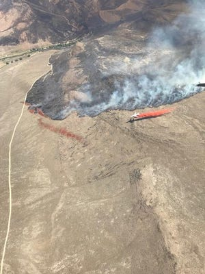 An aerial view of an air tanker dropping retardant on the Martin Fire near Winnemucca.