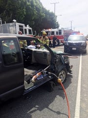 Ventura firefighters extricated a trapped driver Monday afternoon after a two-vehicle crash on Foothill Road.