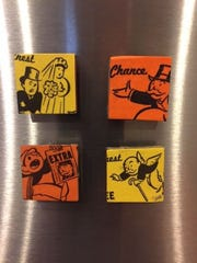 I made these magnets using Monopoly game cards. How