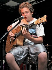 Andrew Bazzi performs a song at Connection Church in Canton during his middle school years.