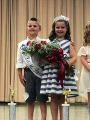 Davis Trammel and Finley Beck, winners of the 2018 Henderson County Fair's Little Mister and Miss Pageants, post onstage at North Middle School.