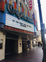 Tyrese Parker, 19, leaps in front of the marquee for