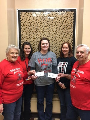 """The """"Old High"""" class of 1962 held a 55 year class reunion 9-29 & 9-30 2017. Thanks to several generous donors we were able to donate $2800 back to the school for audio equipment for the auditorium and to help kids purchase annuals that might not be able to otherwise buy them. From left to right, classmate Mary Lynn Owens (Boyd), Debbie Pepper, Jackie Wheat (Principal)  Heather Ziinny and classmate Doug Lincoln."""